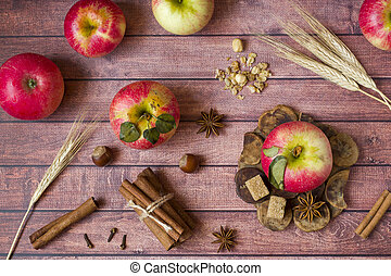 Fresh red apples, spicy spices cinnamon, anise and cloves. Autumn concept