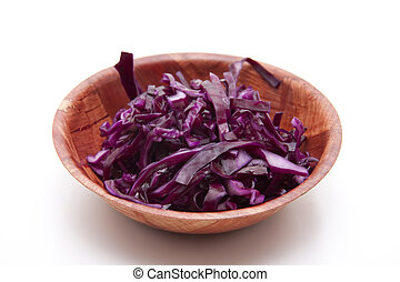 Fresh red cabbage in wooden bowl