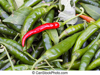 Fresh Red Cayenne pepper on pile of green Cayenne pepper