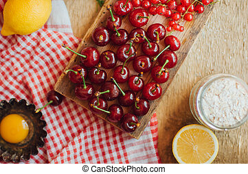 Fresh red cherries on a rustic wooden table. Ripe cherries i o