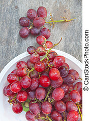 Fresh red grape on white plate