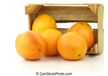 red grapefruits in a wooden box