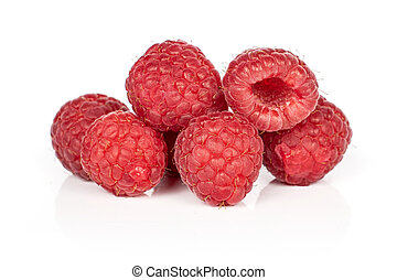 Fresh red raspberry isolated on white