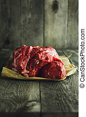 Raw meat on a wooden background