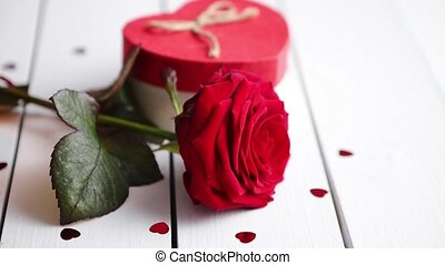 Fresh red rose flower on the white wooden table - Single...