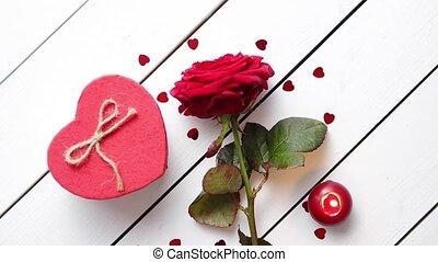 Fresh red rose flower on the white wooden table - Single...