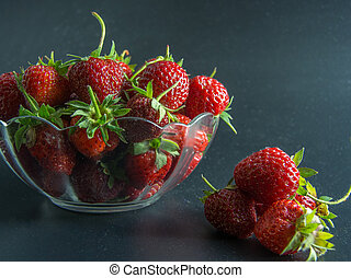 fresh red strawberries in a bowl