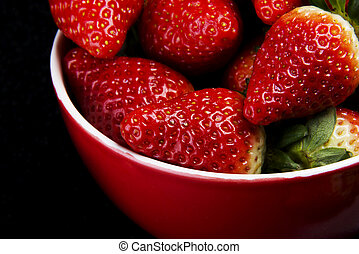Fresh red strawberries in a bowl.