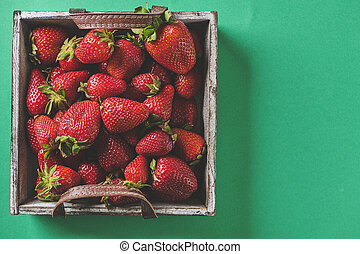 Fresh red strawberries in a wooden basket