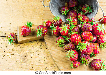 Fresh red strawberries on a cutting board