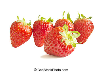 Fresh red strawberry focus on foreground and isolated on...