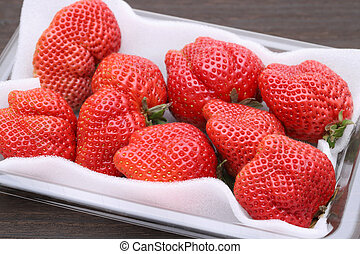 fresh red strawberry in opened plastic box