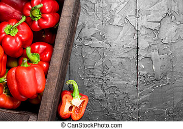 Fresh red sweet pepper in the box.