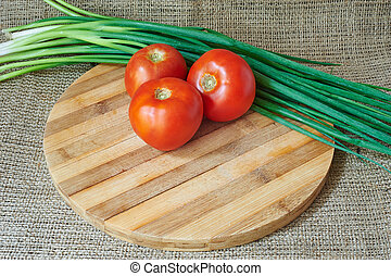 Fresh red tomatoes on a wooden tray