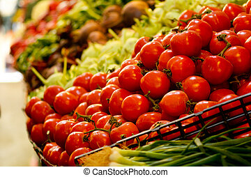 Fresh red Tomatoes on display in a market