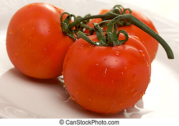 Fresh Red Tomatoes on White Plate