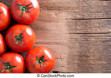 Fresh Red Tomatoes on Wooden Table with Copy Space