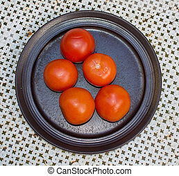 Fresh red tomatoes plate