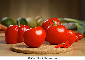 Fresh red vegetables on a wooden board