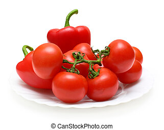 Fresh red vegetables on plate