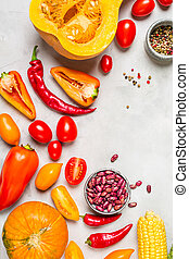 Fresh Red Vegetables. Pumpkin, Pepper and Tomatoes on a gray background