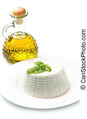 ricotta - fresh ricotta with basil leaf