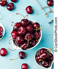Fresh ripe black cherries in a white bowl Top view