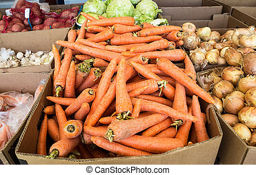Fresh ripe carrot and over vegetables of new harvest ready to sale at the farmers market