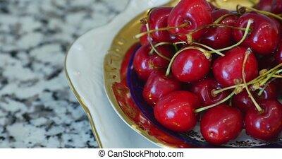 Fresh Ripe Cherries on a Plate