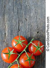ripe cherry tomatoes on wood