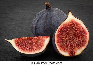 fresh ripe figs on dark background close up