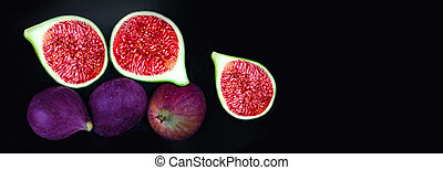 Fresh ripe figs on dark background,  top view. Copy space