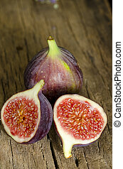 fresh ripe figs - Ripe figs on wooden background