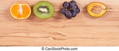 Fresh ripe fruits as healthy eating, place for inscription on plank