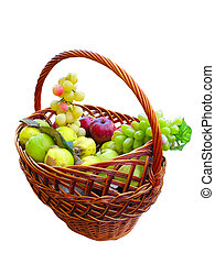 Fresh ripe fruits in a wicker basket isolated