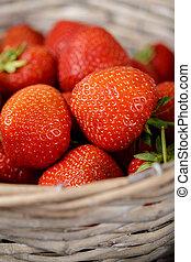 Fresh ripe garden strawberries in a basket