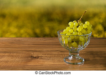 Fresh ripe grapes on a wooden table, rustic style
