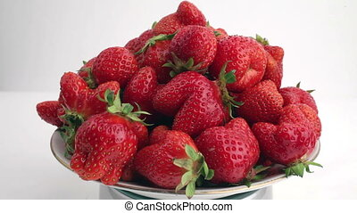 The ripe, juicy strawberries rotate