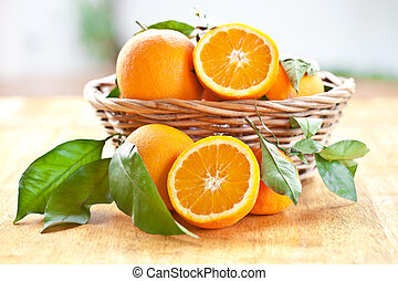 Fresh ripe oranges in a wooden basket