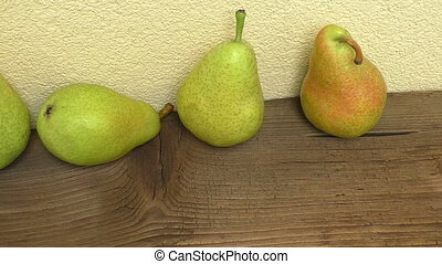 Fresh ripe organic pears on rustic wooden table
