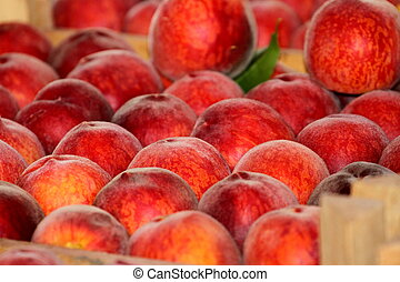 Fresh ripe peaches in the box