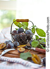 Fresh ripe plums in a basket