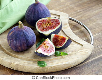 Fresh ripe purple figs whole and sliced