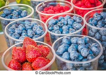 Fresh ripe raspberries and blueberries