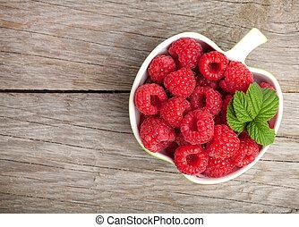 Fresh ripe raspberries bowl