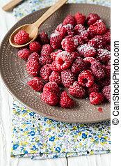 fresh ripe raspberries on a plate