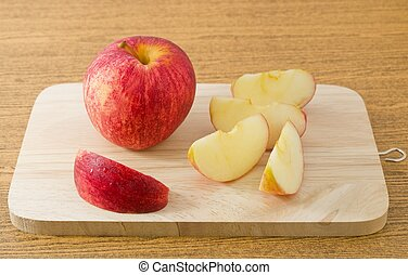 Fresh Ripe Red Apple on A Wooden Tray