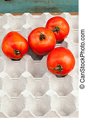 fresh ripe red tomatoes in the box