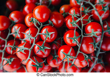 Fresh ripe red tomatoes in wooden box in the market for sale