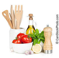 Fresh ripe vegetables, condiments and kitchen utensils. ...